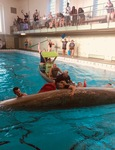 Students with Canoe in Swimming Pool by Tori Senica