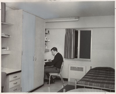Dorm Room and Student Studying
